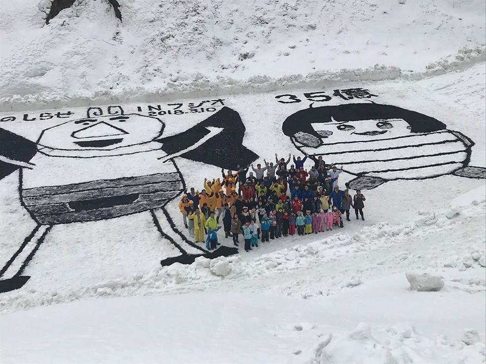 雪上燻炭アート製作